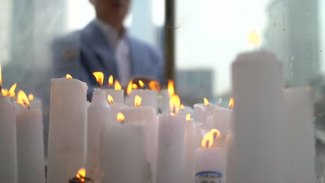 CU-Candles-at-a-Buddhist-Shrine