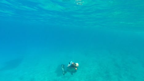 Man-Snorkelling-in-Clear-Blue-Sea