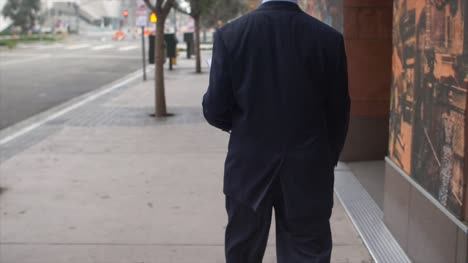 Smartly-Dressed-Man-Walking-on-Sidewalk