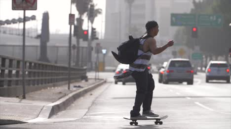 Man-Skateboarding-In-Downtown-LA