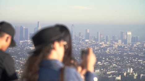 Tourists-Photographing-LA-Skyline