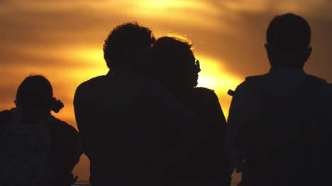 Silhouetted-Couple-Against-Sunset
