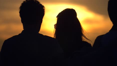 Couple-Taking-Photo-at-Sunset