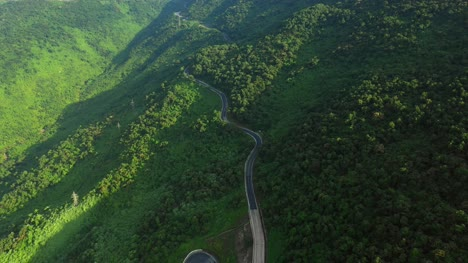 Road-Winding-Through-Forested-Hills