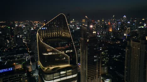 Flying-Round-Bangkok-Skyscrapers-at-Night