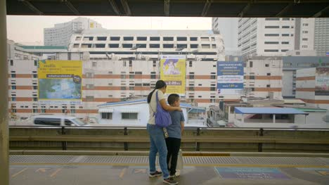 Mother-and-Son-on-Train-Platform