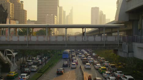 Footbridge-and-Traffic-in-Bangkok-at-Sunset