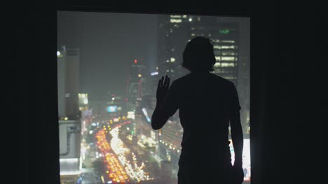 Silhouetted-Man-Looking-Out-of-Window