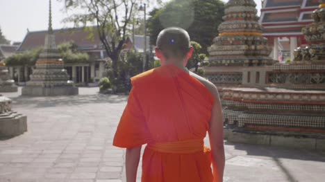 Buddhist-Monk-Walking-Through-Temple