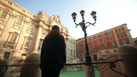 Woman-Looking-At-Trevi-Fountain