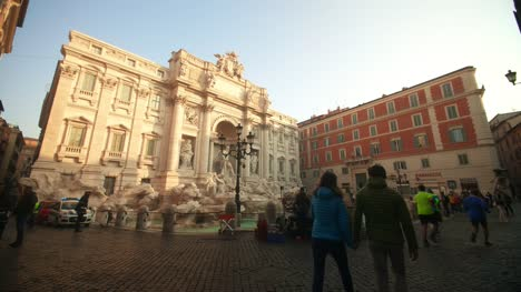 Couple-Walking-Past-Trevi-Fountain