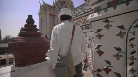 Man-Walking-Through-Wat-Arun-Temple