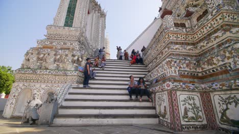 Tourists-Sitting-on-Steps-of-Temple