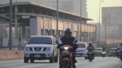 Mopeds-on-Taksin-Bridge-Slow-Motion