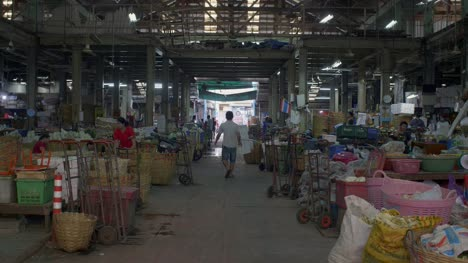 Man-Walking-Through-Bangkok-Market