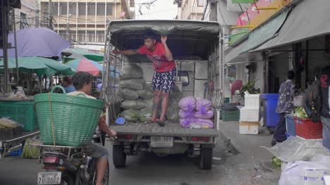 Man-Standing-in-Produce-Truck