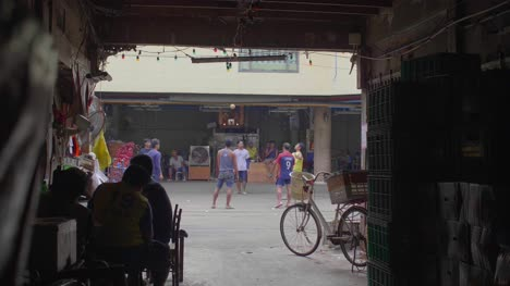Men-Playing-With-Football-in-Bangkok