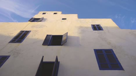 Whitewashed-Building-with-Blue-Windows