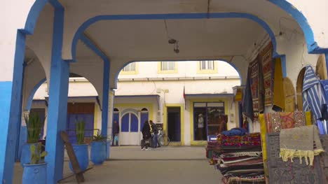 Colourful-Archway-With-Carpet-Stall