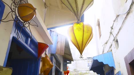 Yellow-Lantern-Hanging-in-Alleyway