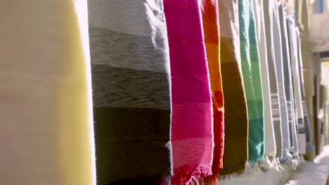 Colourful-Fabrics-Hanging-From-Wall-CU