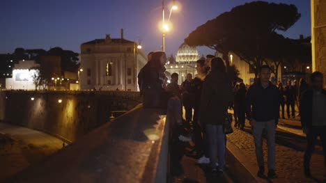 Young-People-on-Bridge-Wall-at-Night