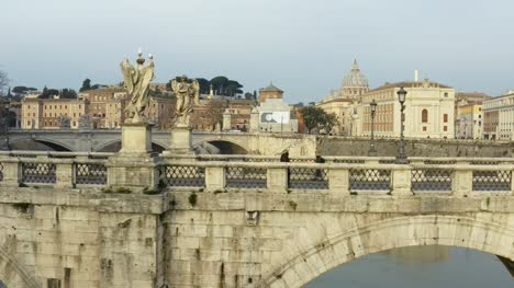 People-Walking-Across-St-Angelo-Bridge