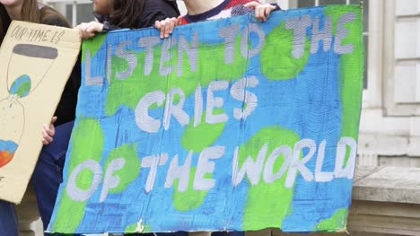 Listen-To-the-Cries-of-the-World-Protest-Sign