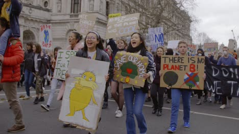 Young-Climate-Change-Protestors-with-Signs