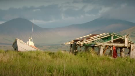 Boat-and-Hut-in-Alaskan-Grassland