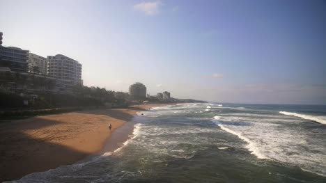 People-Walking-Down-Umhlanga-Beach