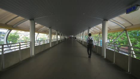 Man-Walking-Down-Walkway