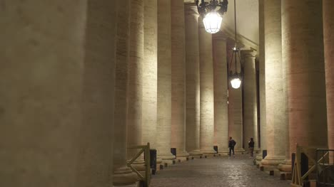 Tourists-Walking-Down-Colonnade