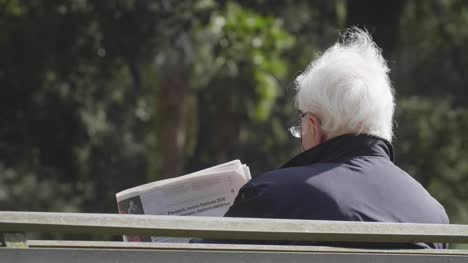 Close-Up-Of-Reading-Newspaper-