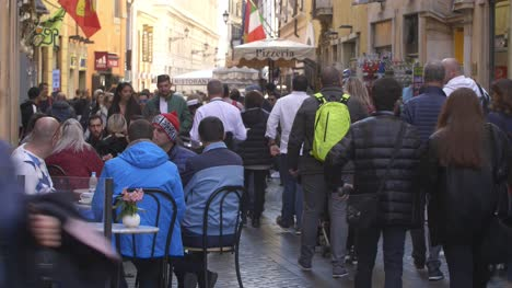Tourists-Sat-Outside-In-Busy-Street