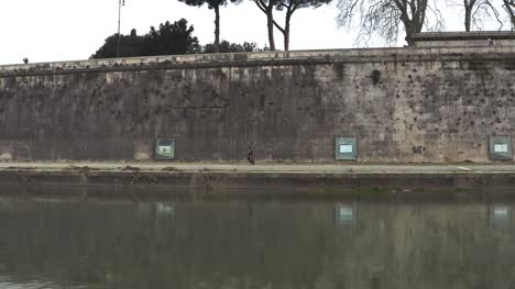 A-Person-Running-Along-The-Tiber-River