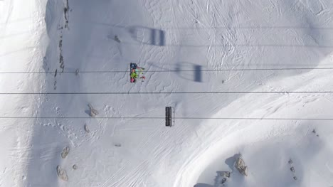 Skiers-on-Chairlift-from-Above