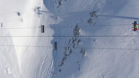 Skiers-on-a-Sk-Lift-from-Above