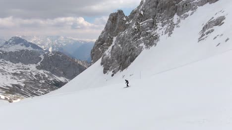 Following-Skier-Down-Mountainside