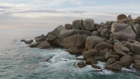 Small-Waves-Crashing-On-Rocks