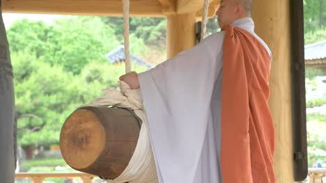 CU-Buddhist-Monk-Striking-Bell