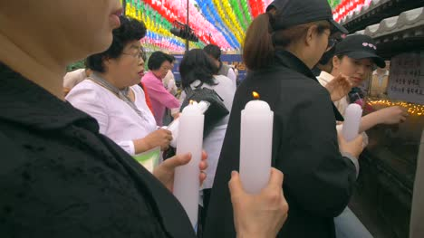 Lighting-Candles-At-a-Buddhist-Shrine