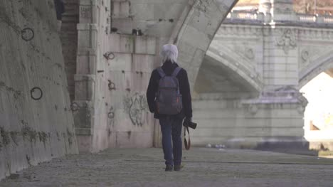 Person-Walking-Along-The-River-Tiber