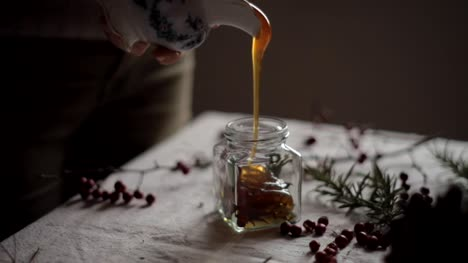 Pouring-Honey-into-a-Jar
