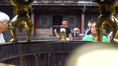 Women-By-Incense-Pit-Lungshan-Temple-Taipei-