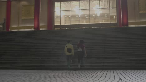Women-Walking-Up-Staircase-Taipei-