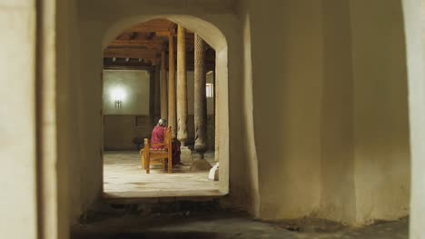 Woman-Sitting-in-Juma-Mosque