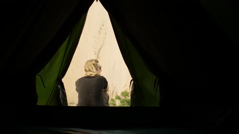 Woman-Sat-Outside-Tent