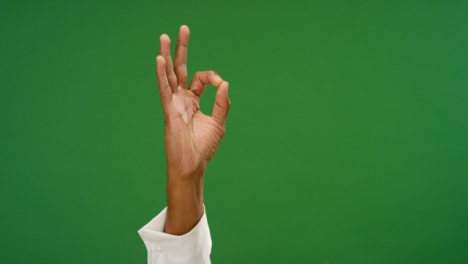 Male-hand-making-OK-gesture-on-green-screen