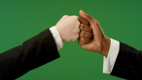 CU-Colleagues-fist-bump-on-green-screen
